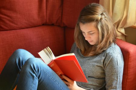 Girl reading teen book