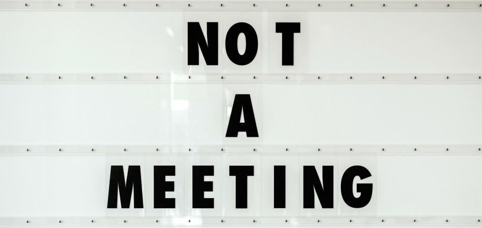 "A New Reality At Work: Signboard saying ""Not A Meeting"""