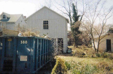 dumpster in front of the original location for Saks Lumber