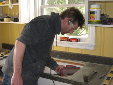 finish edges of a postform laminate counter using a belt sander