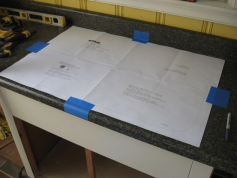Installing a Self Rimming Sink :: cast iron sink template taped down - The template shows the exact size of the sink