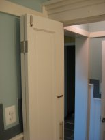 """Reinvented. Salvaged door into a bi-fold. You can see some of the trim detail in hallway. All trim recoveraged from under about 12"""" of snow and profiled on site."""