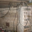 low voltage wiring hanging from a basement ceiling