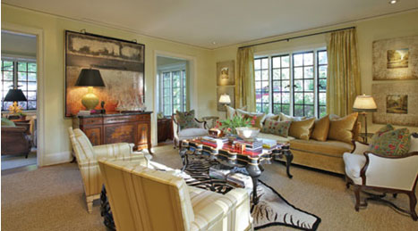 lightening a living room with touches of ivory and gold