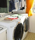 Small Station Laundry Center white high efficiency washer and dryer