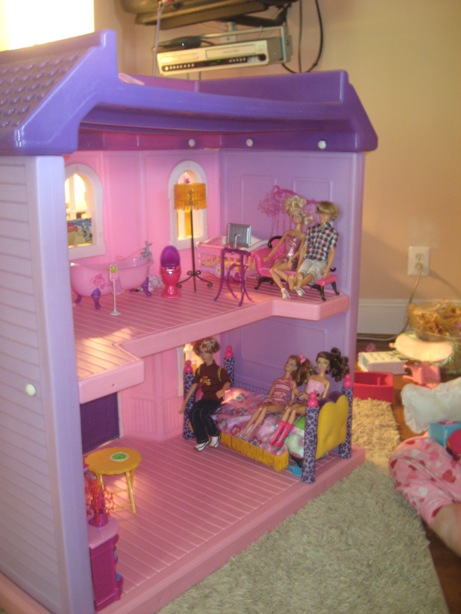 Boy and Girl Barbies Hanging In Staged Dollhouse