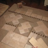 tile layouts for shower done on bedroom floor