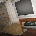 tube type tv sitting on letter top table