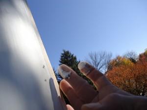 excess caulk to fill nail holes