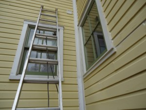 ladder at windows wood trim and siding caulked