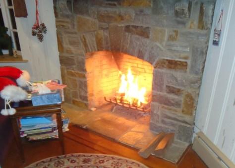 Lit Fire Stone Fireplace
