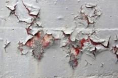 close up peeling-paint on concrete image via Justin Krutz