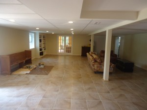 Large Open Basement Remodel with Built-in and French Doors