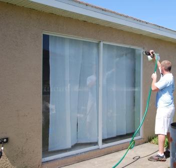 AMPLIFI System used for cleaning a sliding glass window