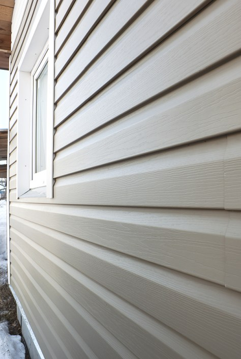 Wall Finished In Vinyl Siding close-up image via Cunningham Contracting