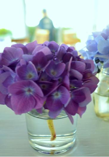 purple flower bunch in clear glass