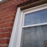 Window Cap with Brick Bend Back-caulked Reinstalled