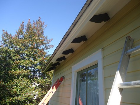 old house eave with angled fascia prepped with Peel Bond