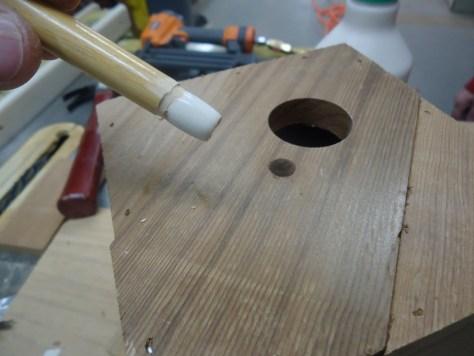 cut sanded glued pool cue as a perch