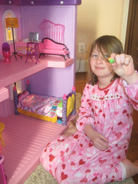 7 year old and a doll house