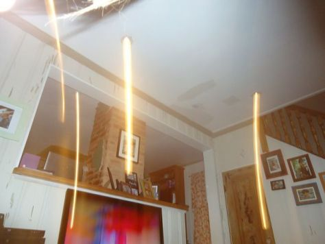 light beams coming from recessed lights
