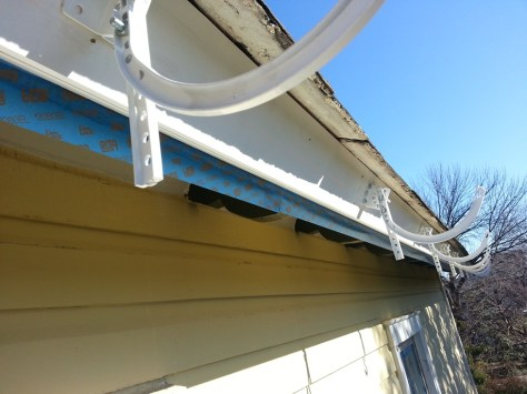 painting fascia before installing half round gutters