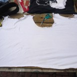 5. Lay the now split shirt flat and prepare for tearing the shirt into two