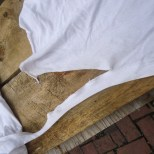 6. At the bottom of the second length-wise tear, continue along the shirt's bottom seam (don't cut through)