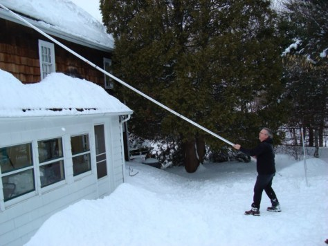 John Poole home made roof rake in action