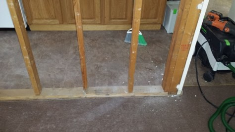 drywall removed from framing of a wall
