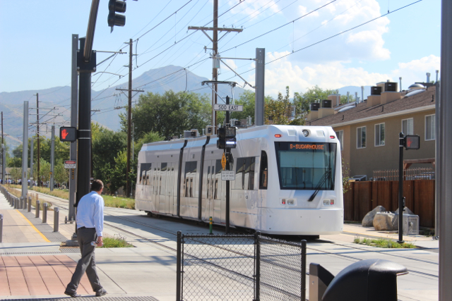 A streetcar passes 500 East along the S-Line Greenway. Photo by Isaac Riddle.
