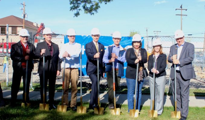 Mayor Becker and other city leaders pose for a picture during a groundbreaking ceremony for the Ballpark Apartments. Photo by Isaac Riddle.