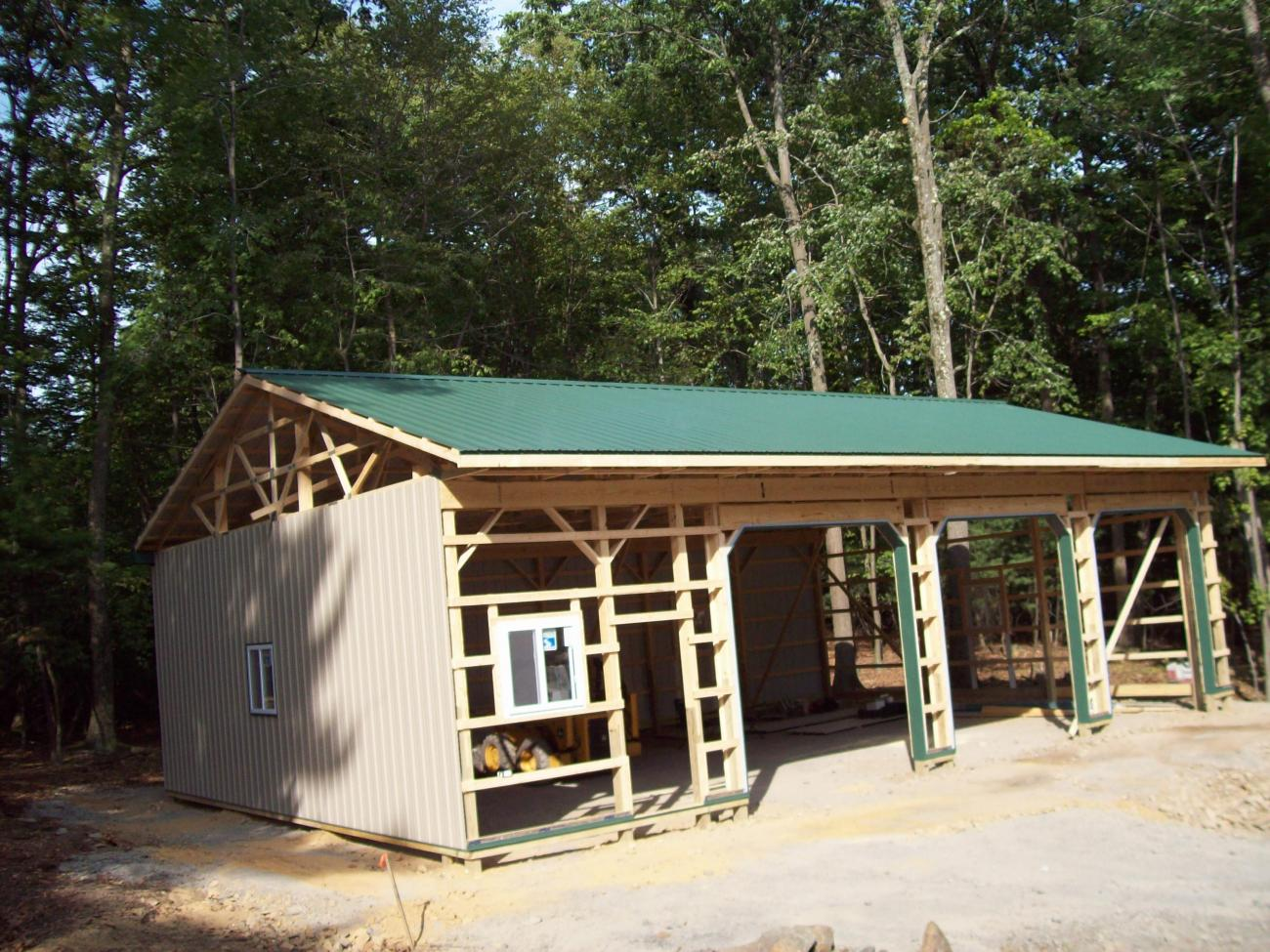 hight resolution of pole barn during construction with some siding and roofing added