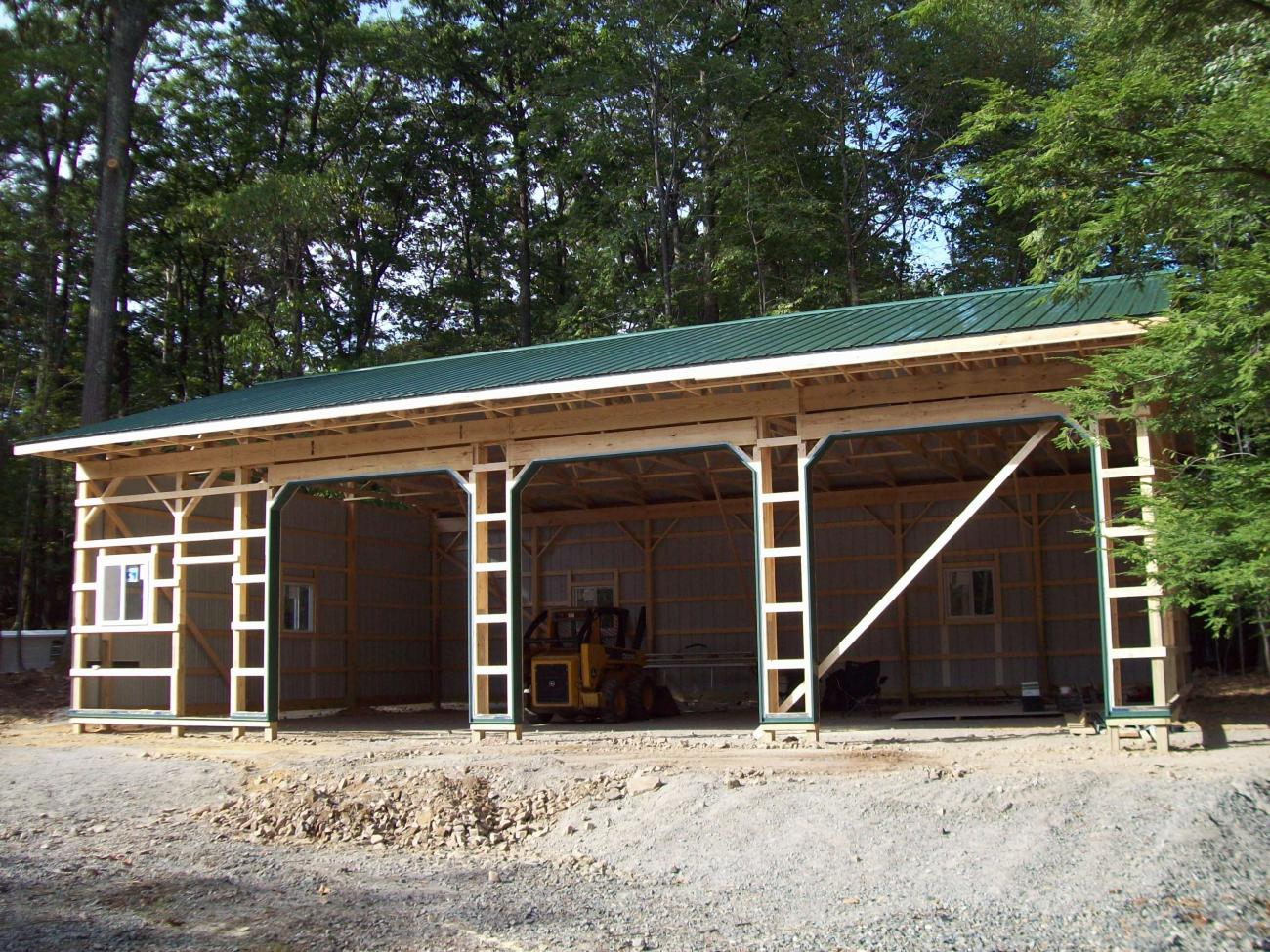 medium resolution of pole barn during construction with some siding and roofing added