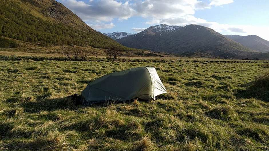 05.Alongside the River Affric, near Athnamulloch. Eighteen miles in. This was my room for the first night: a Mountain Hardware SuperMega Ultra-Light tent, all two pounds and two ounces of it. Those are the Glen Shiel mountains in front of me. It would get into the 20s on this night. I put on every stitch of clothing that I carried and zipped my wife's sleeping bag around everything but my nose. I can say that it was wise not to have had any beer before pulling off this stunt.