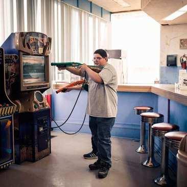 "Boy at Video Game, ""Big Buck"", Springfield, TN"