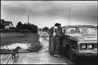 A Humid Day, Rotan Switch, Arkansas Frances' children stand along side the car, having no air conditioning in their home, they escape the humidity by sitting in the car with the AC and radio running.