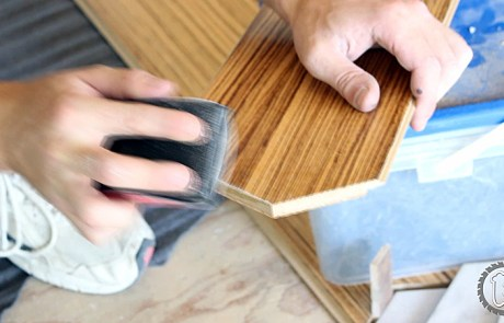 Sand a bevel by hand into the end of cut