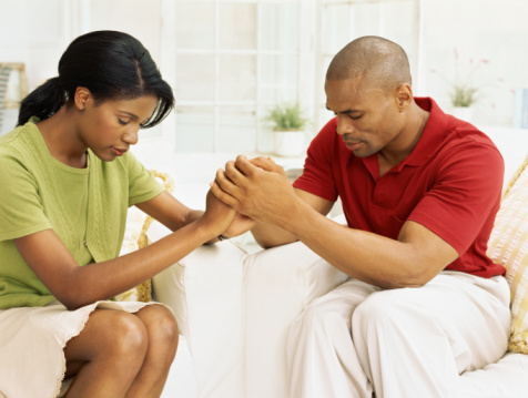 Couple trusting God in prayer