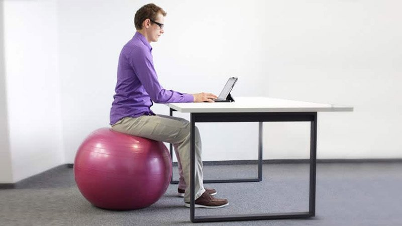fitball balance ball chair high end computer or stability what s better to sit on at work builtlean is sitting an exercise a bad idea