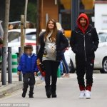 Barcelona superstar, Lionel Messi enjoys a stroll with his pregnant wife and son
