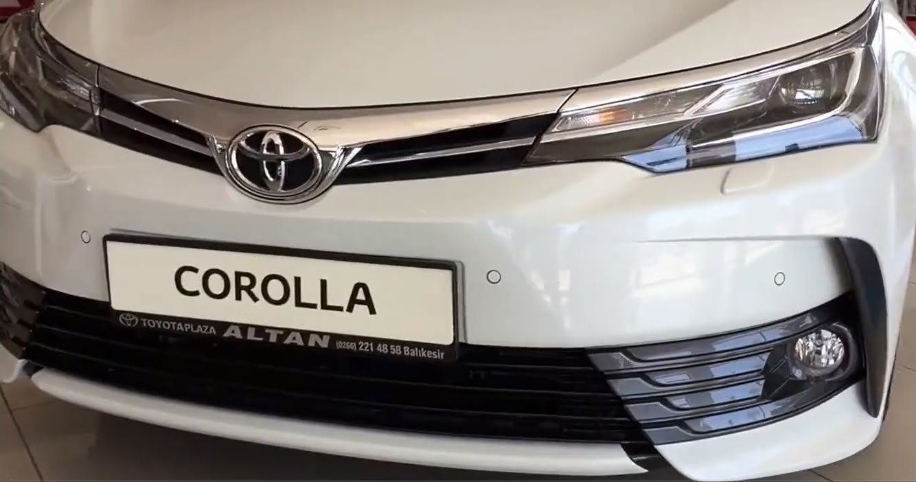 new corolla altis grande grand veloz 1.3 silver toyota launches its facelifted car in pakistan