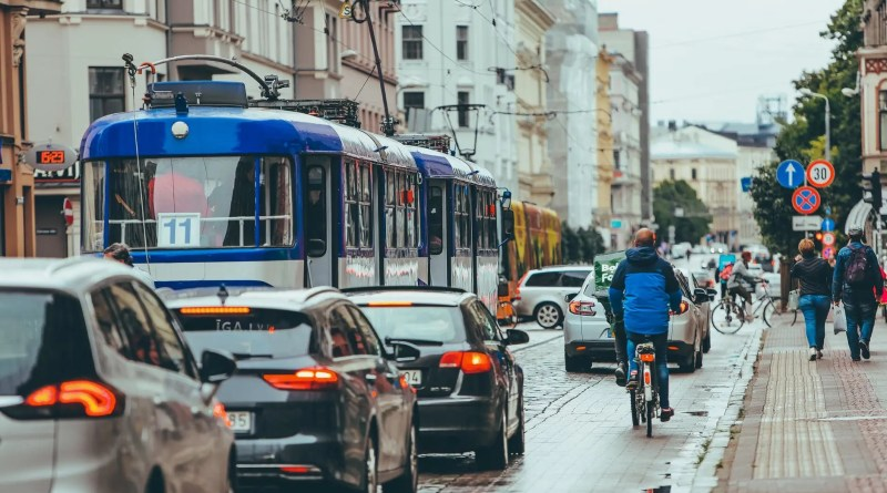 tram and cars in traffic jam at rush hour