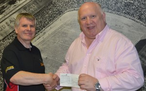 Mark Hobson of Hamtune Spares & BCB commentary team, hands over sponsorship cheque