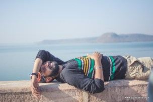 Bulleteer Puneet Singh trying to take a short nap on the wall of tighra dam