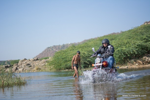 bulleteer somesh khatuja making his way through the water crossing. This narrow river is actually water seeping from the cracks in the dam