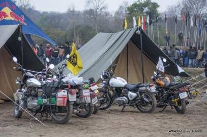 Royal Enfields parked outside a tent at tent city during rider mania 2015