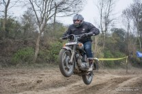 An air borne rider on his royal enfield during the time trials at Rider Mania 2015