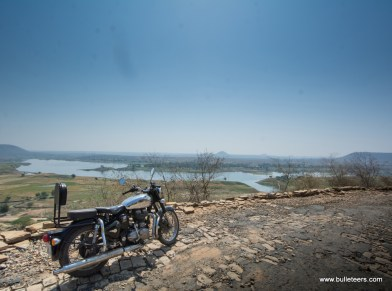 a royal enfield classic 500 with a long backrest shot on the way to pagara dam