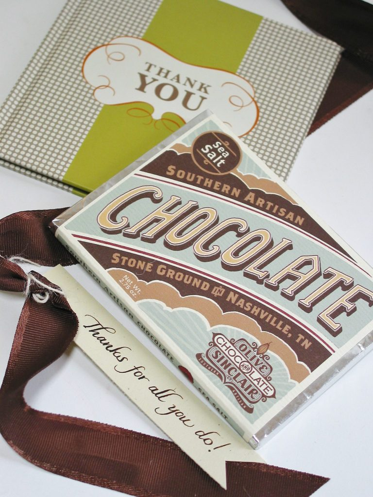 custom thank you gift at bumble B design: Olive & Sinclair chocolate bar, Thank You book from Compendium Inc., & hand-calligraphed thank you tag